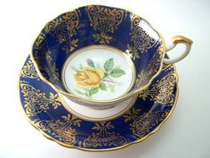 Antique Paragon Blue Tea cup and Saucer, Cobalt blue and gold tea cup with Yellow roses, Gold scroll on Navy Blue tea cup. by AntiqueAndCrafts on Etsy https://www.etsy.com/listing/209604462/antique-paragon-blue-tea-cup-and-saucer