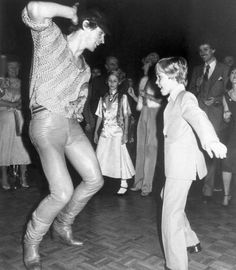 """Dancer Rudolf Nureyev initiates nine-year-old Ricky Schroder into the delights of disco dancing at Studio 54 in New York on Sunday, April 2, 1979. Ricky had previously attended the preview of the remake of """"The Champ"""" in which he stars with Jon Voight. (AP Photo/Quinto) Ref #: PA.9175553  Date: 02/04/1979"""