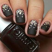 Black matte nails with silver sparkles.