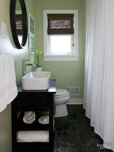 Two avid DIYers transformed their 7x6-foot hall bathroom into a polished, serene space. They achieved their updated look with smart shopping and by doing most of the work themselves. To make the small room feel larger, they chose a color scheme of soft green, white, and brown. Total Cost: $2,069/
