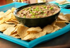 Chipotle Chicken Bean Dip: A can of soup, a can of refried beans & 7 minutes are all you need to whip up a bean dip that's bursting with flavor.