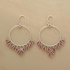 """A delicate fringe of pale pink garnets endows our exclusive sterling silver loops with feminine allure. French wire. Handmade. 1-3/4""""L."""