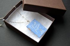 """This listing is for a silver plated chain necklace 18"""" with tiny book 'Pride And Prejudice'. This book charm is closed. To check for more items in my shop: https://www.etsy.com/shop/GeweldigJewelry  #prideandprejudicebook #miniaturebooknecklace #prideandprejudicebooknecklace #silvernecklacewithbook #janeausten #janeaustenbook #janeaustenbooknecklace #bookjewelry #etsyshop #colgantelibro #orgulloyprejuiciolibro #janeaustenlibro"""