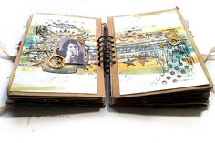 finnabair art journal. looks like she did her art, then attached the paper to actual journal. Really like this idea...