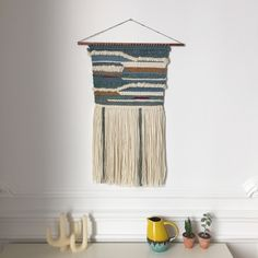 Handmade Wall Weaving.Cotton, lightly sparkling blue wool, natural wool, copper stick.75cmx36cm (including the fringes)