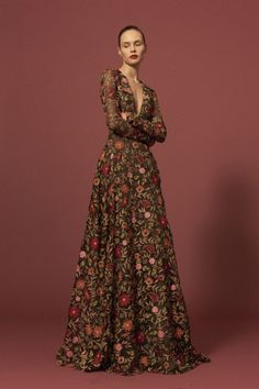 Long sleeve gown v-neck with fitted waist and A-line skirt. Multi-color threadwork floral garden motif available on black or olive green organza. Naeem Khan