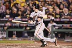 PITTSBURGH, PA - OCTOBER 01: Buster Posey #28 of the San Francisco Giants lines out to center in the fifth inning against the Pittsburgh Pirates during the National League Wild Card game at PNC Park on October 1, 2014 in Pittsburgh, Pennsylvania. (Photo by Jason Miller/Getty Images)