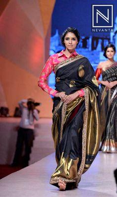 A wonderful combination of black #banarasi saree with a full-sleeve #pink blouse