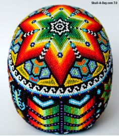 """Jake Maughan recently finished his Huichol Skull. He explained """"We saw this beautiful artwork in Mexico and it was one of the few thing. Polymer Clay Sculptures, Sculpture Clay, Restaurant Mexicano, Yarn Painting, Mexico Art, Skeleton Art, Native American Beadwork, Paper Embroidery, Arte Popular"""