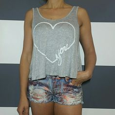 """""""Love you"""" tank top! NWOT Brand new no tags  Cute and comfy """"Love you"""" tank top. Heart has a cool rubbery feel. Adorable lace detail across the back. Pair with leggings, jeans or shorts for a sassy outfit.  Material 96% rayon 4% spandex  Length of the size large approx 20.5"""" Length of the size small approx 18.5 Tops Tank Tops"""