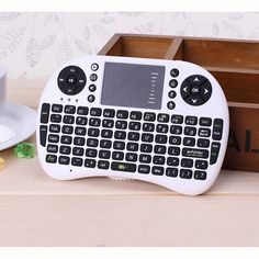 Black and White Mini Keyboard 2.4G Wireless Keyboard Mouse Touchpad Design for PC Notebook Android TV Box Handheld Keyboard HTPC  http://playertronics.com/products/black-and-white-mini-keyboard-2-4g-wireless-keyboard-mouse-touchpad-design-for-pc-notebook-android-tv-box-handheld-keyboard-htpc/