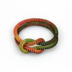 Claire Kahn at Patina Gallery. Bracelet, Orange Red and Green Weaver