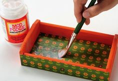 Fabric Mod Podge STEP SIX: Smooth, Smooth, Smooth. Keep smoothing until all of the bubbles are removed. Then, AND THIS IS IMPORTANT, let  your project dry for 15 – 20 minutes. Don't put a top coat on right away.