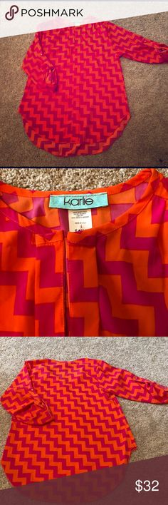 "KARLIE BEAUTIFUL TUNIC, EUC Karlie orange and hot pink tunic top, excellent condition. My daughter barely wore it. Color combination pops!!  Rounded hem. Back length is 27.5"". Front length at its longest is 24.5"". Sleeve length is 12"". Sleeves are elbow length and secured with a matching button. The sleeves can not be unbuttoned. Can be dressed up or done. 100% polyester. Hand wash, lay flat to dry. Very pretty!! Karlie Tops Blouses"