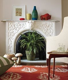 Home Makeover Ideas Stick a plant inside a (non-working) fireplace.Stick a plant inside a (non-working) fireplace. Unused Fireplace, White Fireplace, Faux Fireplace, Decorative Fireplace, Fireplace Modern, Bedroom Fireplace, My Living Room, Home And Living, Living Spaces