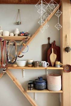 Lots of small space ideas. I really dig this cross beam wall storage with the bare wood.
