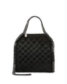 Stella McCartney --- i've never been a big fan of this style, but then I saw this one. zoomed in on the mini studs . . . love!