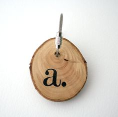 Keychain made with birch wood and cable steel wire with your monogramme hand painted.