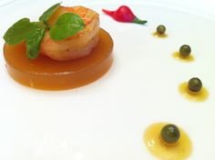 Black tiger with tomato jus and green pepper