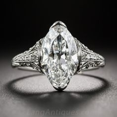 Tiffany & Co. 3.14 Carat 'Moval' Diamond Edwardian Ring. An icy-white, full-figured, old European-cut marquise diamond, with softly rounded tips (sometimes referred to in the trade as a 'Moval' - 1/2 marquise 1/2 Oval), weighing 3.14 carats, is presented with timeless Edwardian elegance and romantic splendor in this platinum and diamond solitaire.