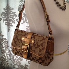 Coach Signature side flap bronze lthr bag REDUCED Coach signature side flap bronze leather trim bag. Includes Coach dust bag. Really great size bag for daytime casual to evening dinner out.  Gently used and lovingly cared for. Coach Bags
