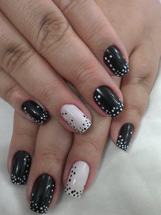 Delicate white dotticure over black with a reverse accent nail!!!  Tres chic!