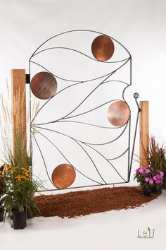 The Copper Leaf Gate's hand bent, clean lines mimics nature's art and is a delightful invitation into any garden.