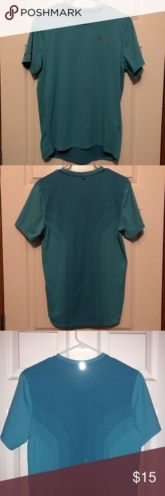Nike running shirt! Nike Running Shirt! Good running shirt but can also be worn casually. Shirt is in good condition. Plenty of ventilation. Some peeling on the inside neck (pictured along with size or shirt). #nike #nikerunning #nikeshirt #nikerunningshirt #running #runninggear #athleticwear Nike Shirts