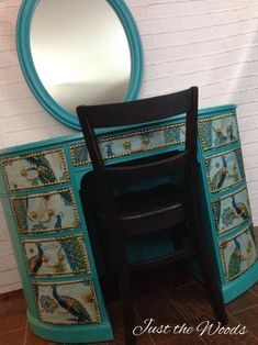 Learn how to paint and decoupage furniture with this gorgeous painted vanity project. Painted furniture with peacock fabric decoupaged to the drawers.
