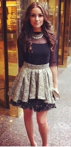 Love this outfit! Olivia Culpo in a sheer black blouse and playful printed skirt. #fun #fashion