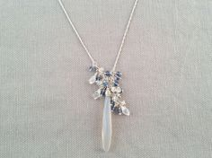 Handmade Necklace with Gray Chalcedony stick, Moonstone, Kyanite clusters by Indiana jewelry artist, Amber Bryce.