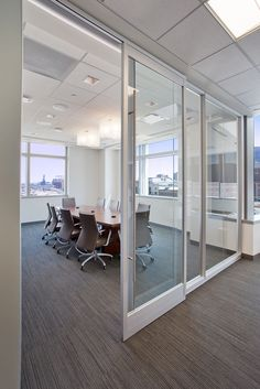 First Western Financial   PRODUCT: DIRTT Segmented Glass Conference Room  With Sliding Barn Doors.