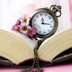 an Old Pocket Watch on a Book