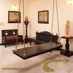 Madhurya brings to you an exquisite collection of #Heritage #Furniture Sit and enjoy in the comfort of your home on this Elegant Jhula / Swing made of Seasoned Teak wood. The simple design would suit any setting whether Comtemporary or Traditional. It is large and spacious and can be hung in your balcony or garden also.The chain used to hand the Wooden Plank is a formation of Artistic brass links, giving it strength and adding on to Classic Beauty…