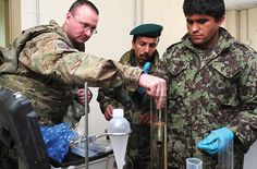 U.S. Air Force advisor shows Afghan airmen proper way to take temperature reading of fuel sample U.S. Air Force (Nadine Barclay)