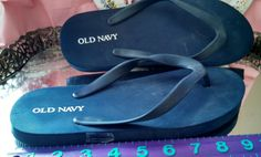 Old Navy dark blue flip flops, sticker marked US size 7. Available for purchase with Silver gray pair.