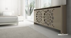 With a unique circular design, this radiator cover will stand out in any room!