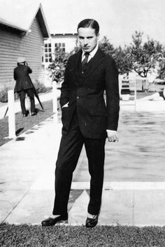 Charlie Chaplin, ca.1919. Standing in front of the pool at Chaplin Studios.