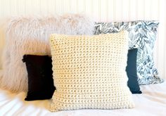 Hi friends! I am a huge fan of super bulky yarn these days and have a LOT of scrap bulky yarn. Today I'd like to share with you a simple way to make chunky pillow covers with your bulky yarn. This is a beginner friendly project because the pillow is made entirely with single crochet stitches. Fun fun! By the way, this yarn is SO cheap at Wal-Mart. It costs $2.97 per skein, so it is completely budget friendly. It's also a really nice way to use up your scrap super bulky yarn! Here ar...