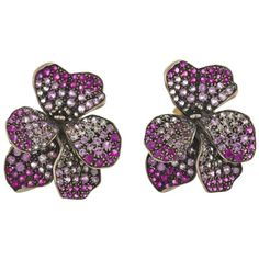 A pair of pink sapphire viola flower earclips, Fred Leighton signed Fred Leighton; mounted in eighteen karat white gold; length: 1 1/4in.