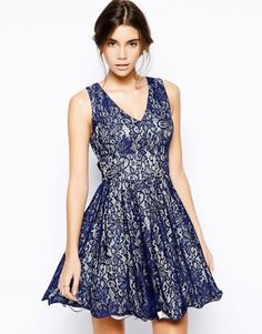 Chi Chi London Lace Dress with Plunge Neck in white with blue overlay from ASOS.