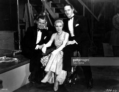 William Powell (1892 - 1984) the Metro Goldwyn Mayer leading man and Regis Toomey (1898 - 1991) the American character actor are sitting either side of Natalie Moorhead, the American actress.