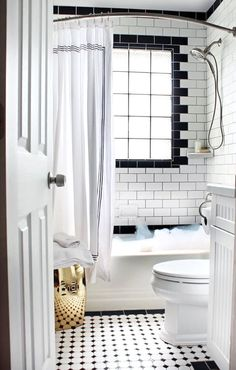 Black is the perfect color to add a little sophistication and excitement to any space, and nowhere is that more true than in the bathroom. From black fixtures to black tile to a black tub, here are ten ways to add a little bit of delicious contrast to your space.