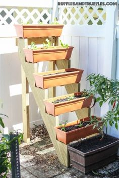 DIY Vertical Planter Garden ~ stair risers with the leftover rain gutter sections …… just need endcaps. DIY Vertical Planter Garden ~ stair risers with the leftover rain gutter sections… Vertical Garden Planters, Vertical Garden Design, Vertical Gardens, Diy Planters, Planter Garden, Tiered Planter, Succulent Planters, Planter Boxes, Hanging Planters