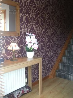 Lovely purple and gold wallpaper.