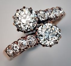 An Antique Crossover Diamond Engagement Ring, Moscow, circa 1880s. The design of this engagement ring is known as a 'Kiss' in Russia and 'Me and You' (Moi et Toi) in France. In 14K rose gold ring, centering two old European cut diamonds, the shoulders with eight old mine cut diamonds. Total diamond weight 3 carats.