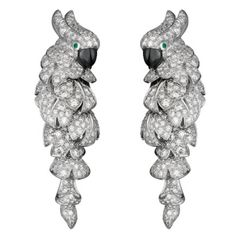 Cartier Fauna and Flora Diamond Gold Parrot Earrings. CARTIER Fauna & Flora Parrot décor Earrings in white gold paved with diamonds, emerald eyes, signed and numbered size 46 x 14 mm Jewelry Tags, Dog Jewelry, Bird Jewelry, Animal Jewelry, Cartier Jewelry, Antique Jewelry, Cartier Earrings, Jewellery, Equestrian Jewelry