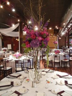 tall purple, red and fuchsia centerpieces designed by tina barrera at moulin
