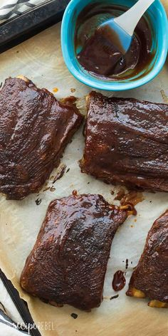 These Easy Slow Cooker BBQ Ribs couldn't be simpler! They have a homemade spice rub and are slow cooked until they fall off the bone, then you can slather them in any barbecue sauce you like! | crockpot | crock pot | crockpot ribs | easy ribs | summer barbecue | father's day | grilling