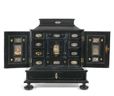 *A Baroque polychrome painted glass mounted and ebonised cabinet, c. 1700. Photo Nagel Auktionen